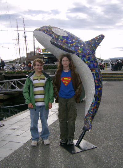 the boys with an orca statue