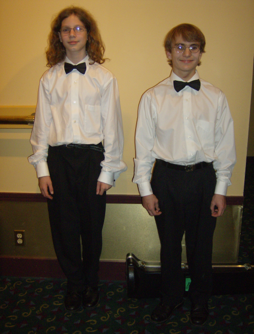 The taller boy on the left is the trombonist, the older boy on the right is the trumpeter, so handsome in their concert attire!