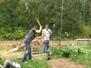 Grant swings to set the fencepost in place