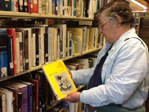 "Mother, holding a copy of Hetty Clew's book, ""The Only Teller"" at the SSI public library.  Hetty used to live on the island, and was a strong supporter of both the library and the arts.  We miss her."