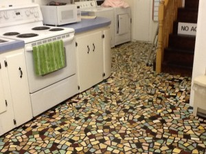The broken-tile floor of the kitchen in the Filberg house in Comox, B.C.  It shows an economical and whimsical way to introduce movement and color (and the slight variations in depth make the floor more comfortable for standing).