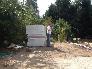 Tom, next to a stack of insulation like the pink stuff under the wire grids.