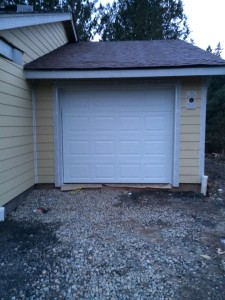 single-car garage and door. Not a lot of space, but enough.