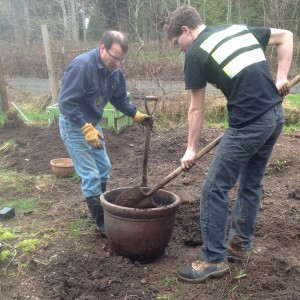 Tom and Grant filling a pot