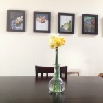 Daffodils on the dining room table, the art-print-calendar we framed.