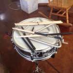 "7"" deep snare drum (used) with two different types of wooden sticks, a pair of wire brushes, two triangles with a striker.  Not shown:  two books with drum patterns to learn..."