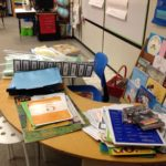 The reading table on Friday-- materials to sort, collate, cut, copy, and use next week!